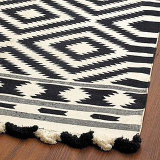 dhurrie rugs a flat woven cotton rug have a rich history that begins in regions such as pakistan india afghanistan and tibet to name a few